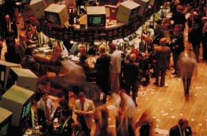 Face-to-face trading interactions on the New York Stock Exchange trading floor.   Financial decisions can be one of those many economic choices people make.